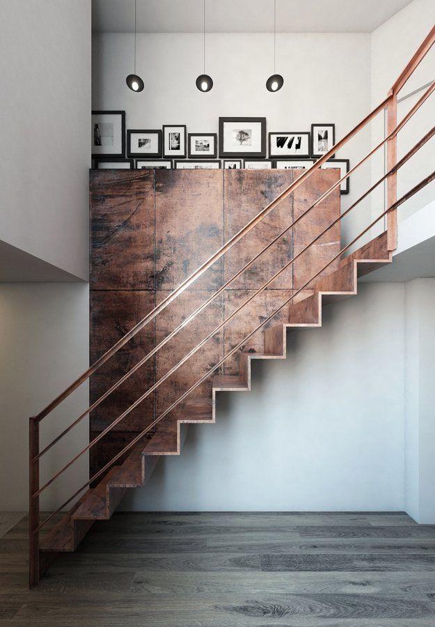 Revestimento da parede segue na escada em ambiente com estilo industrial