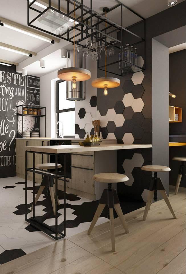 Uma cozinha com estilo industrial cheia de elementos modernos e contemporâneos