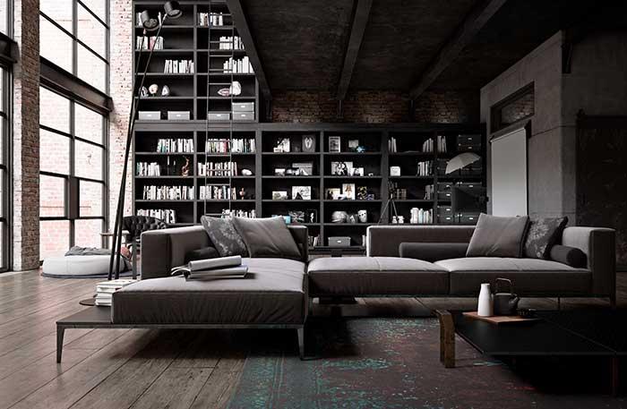 Para acompanhar e aproveitar a altura do pé direito dessa casa, uma estante monumental cheia de livros no estilo industrial