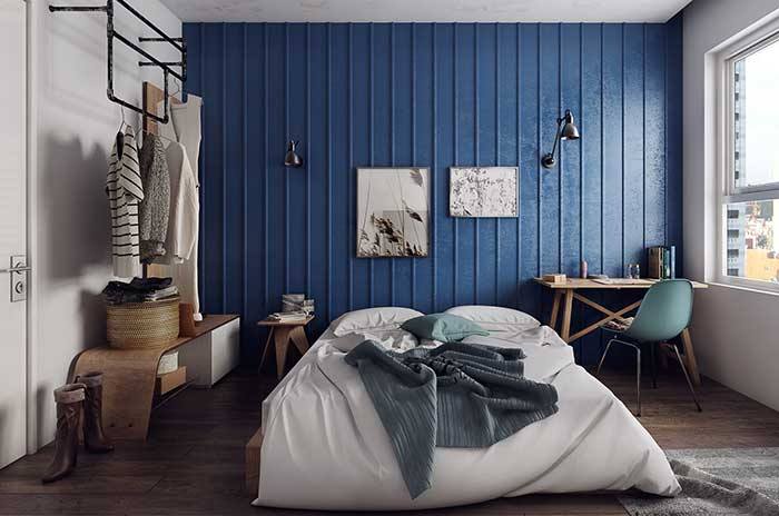Estilo industrial: azul marcante se destaca no quarto, mas sem exageros
