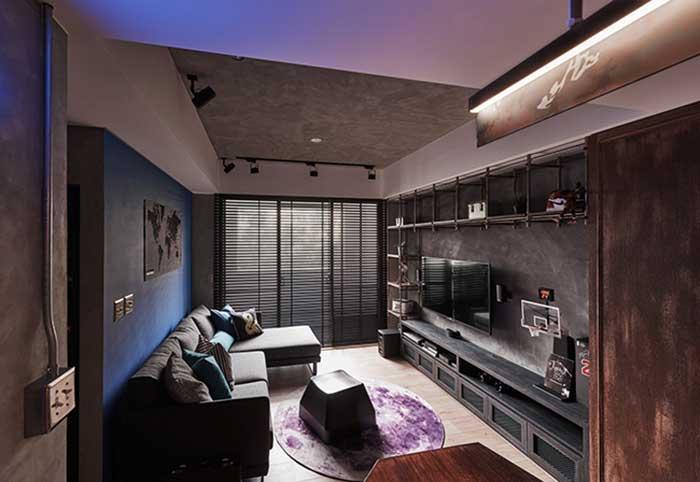 Estilo industrial: iluminação indireta deixa a sala mais acolhedora