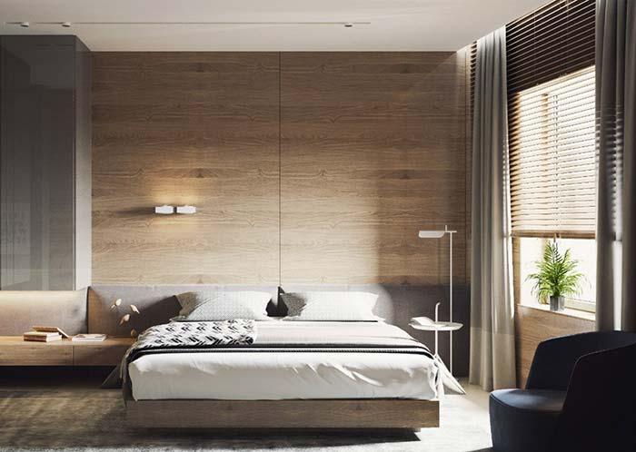 O tom amadeirado da parede se estende para a persiana para quarto também