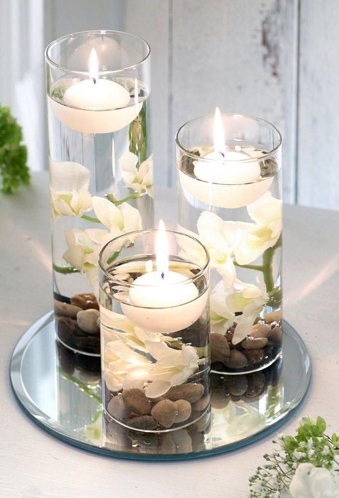 Decoração com flores: uma ideia que vale a pena copiar: pedras, flores, água e velas