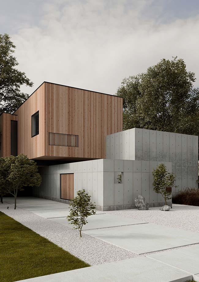 Casa pré-moldada em estilo moderno mescla concreto e madeira