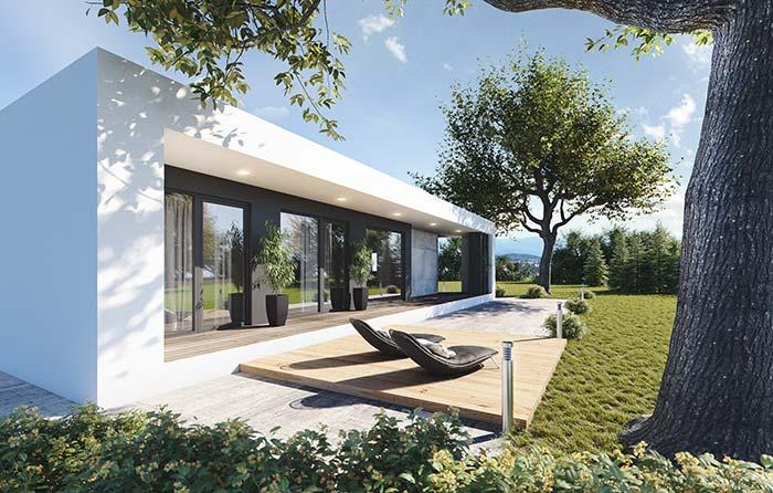 Árvores realçam a beleza da casa de arquitetura pré-moldada