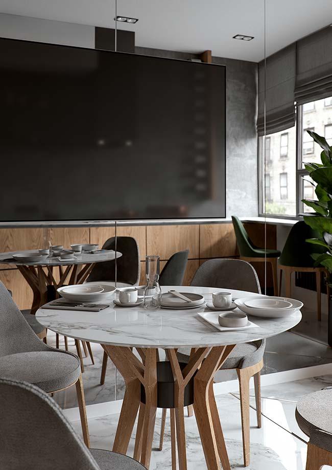Salas de jantar com mesa redonda de quatro lugares e tampo de mármore
