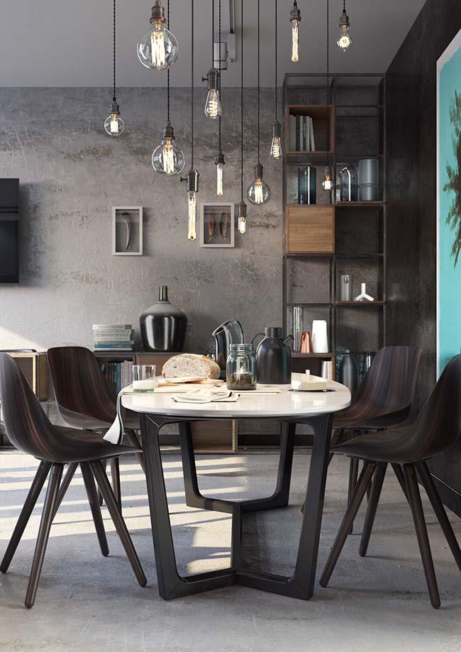 Nessa sala de jantar, a proposta foi usar várias lâmpadas de filamento de carbono para garantir a iluminação e a proposta da decor