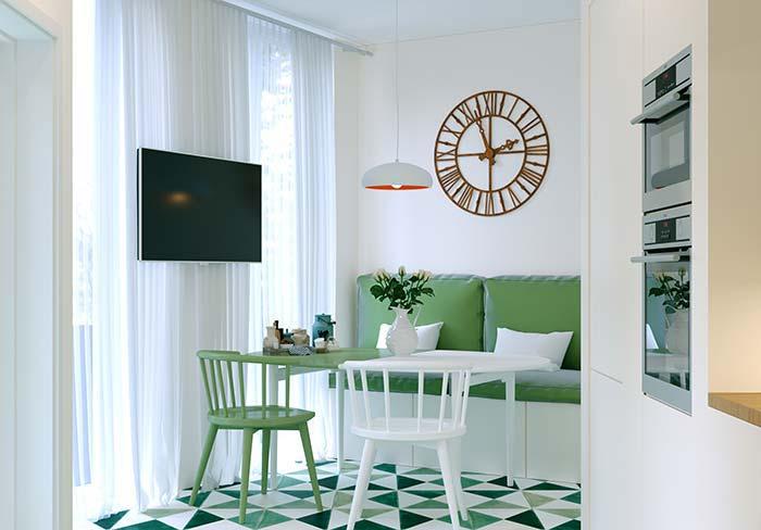Tons de verde e branco predominam na decor dessa sala de jantar