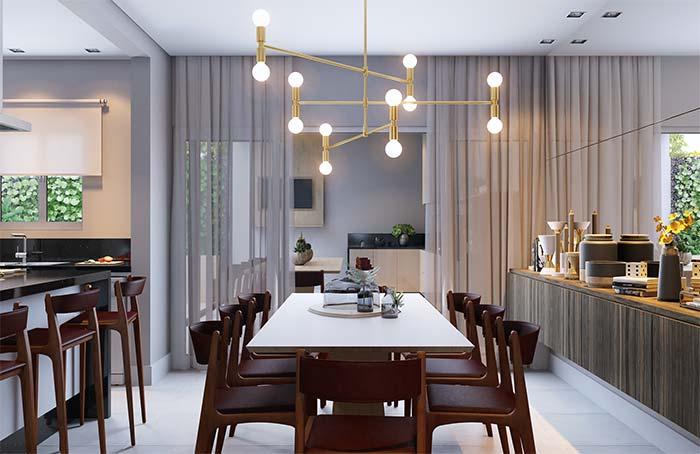 Cadeiras e banquetas dessa sala de jantar seguem o mesmo padrão de cores e materiais