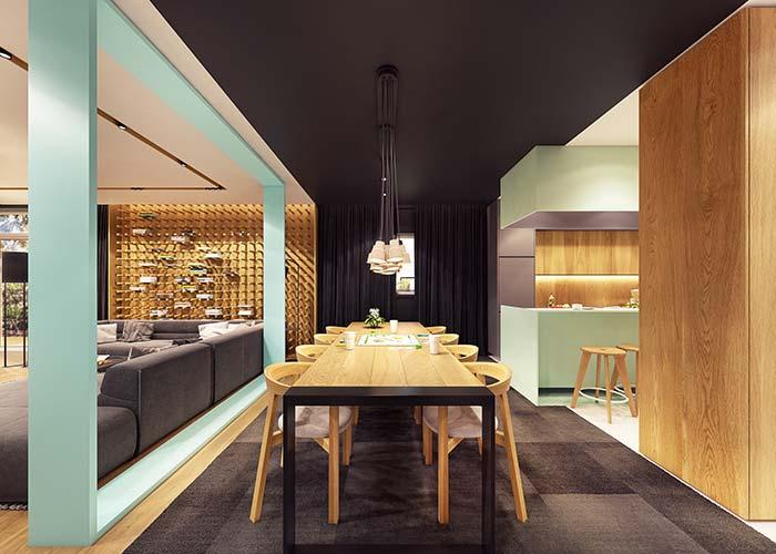 Faixa preta que cobre o chão e o teto é um truque visual para delimitar a área da sala de jantar
