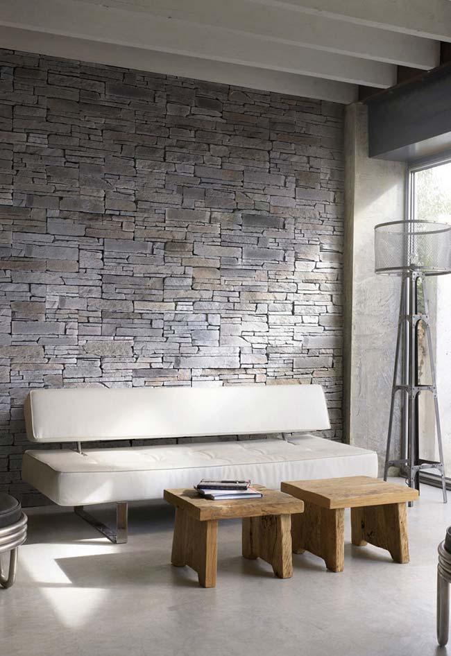 Pedras em filete decoram essa sala de estar de estilo moderno e minimalista