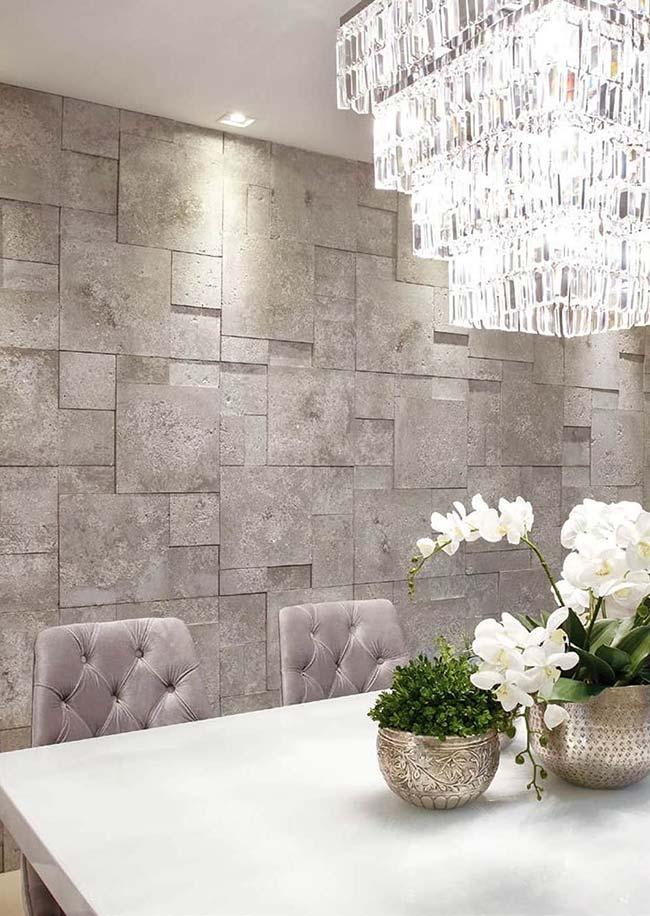 sala de jantar cheia de requinte e sofisticação apostou no uso de pedras decorativas