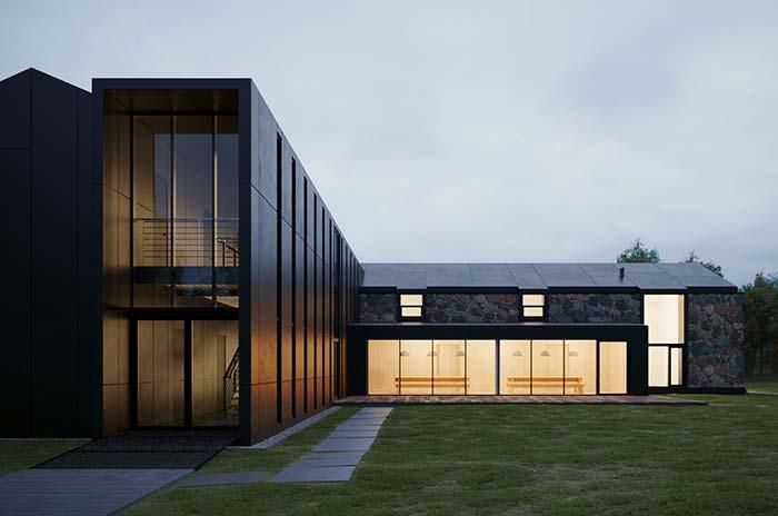 Casa de estrutura metálica e vidro ganhou revestimento de pedra para completar o visua