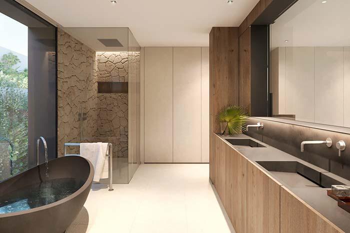 Esse banheiro ganhou um toque especial com o uso de pedras brutas nas paredes do box