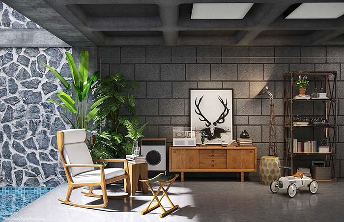 Sala de decoração moderna e descolada conta com parede de tijolos estruturais aparentes