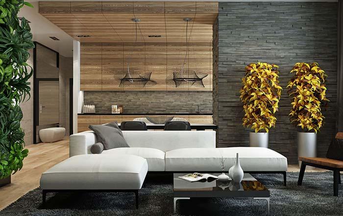 simetria e proporção marcam a decoração desse ambiente integrado com pedras decorativas