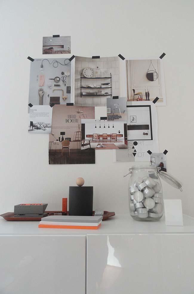 Fotos na parede com decoração de fita isolante