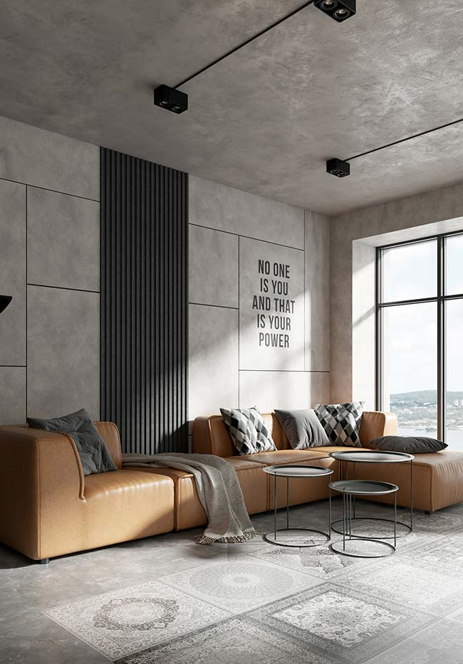 O toque de cor dessa sala de estilo industrial ficou por conta do sofá caramelo