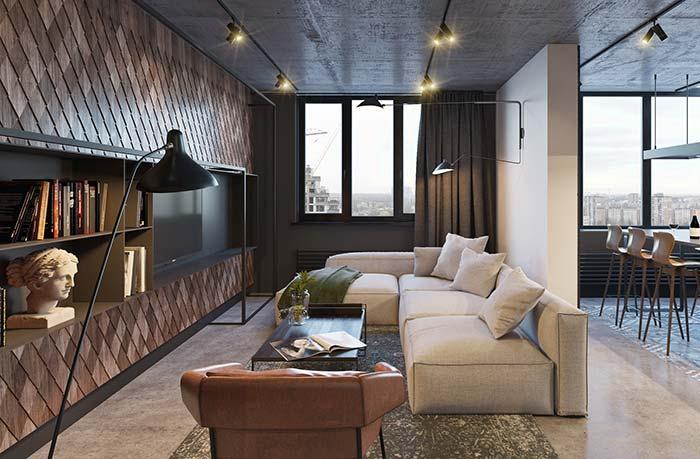 Cores para sala: tom caramelo da poltrona e marrom do revestimento em perfeita sintonia nessa sala de estar