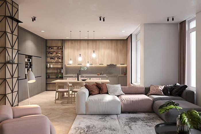 As três cores do sofá – preto, branco e rosa - seguem em todo o restante do ambiente