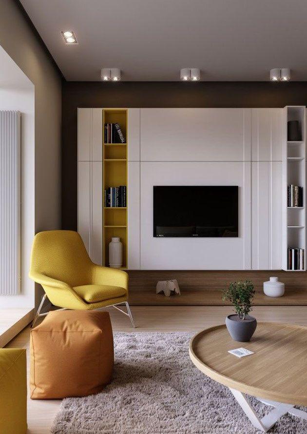 Detalhes em amarelo deixam a sala mais moderna, sem perder a classe e a sofisticação