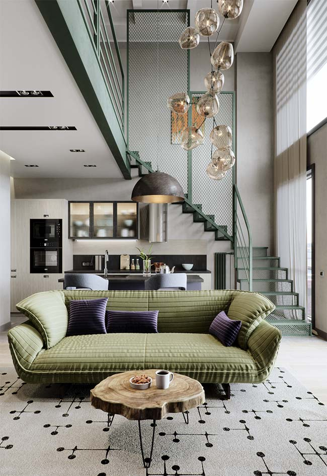 Verde oliva, tendência de cor 2018, foi usado nessa sala em composição com o preto e branco