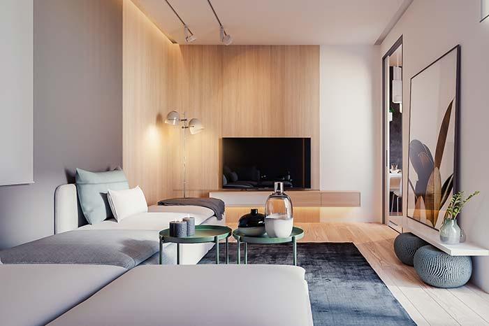 Apoiado sobre a prateleira, o quadro fica estrategicamente posicionado diante do sofá para que possa ser contemplado devidamente