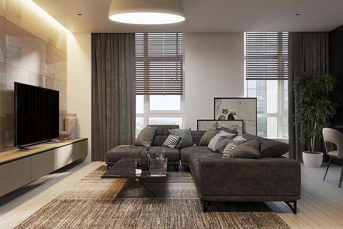 Dupla de quadros posicionada no chão fica praticamente encoberta pelo sofá, mas em uma proposta moderna isso não é problema