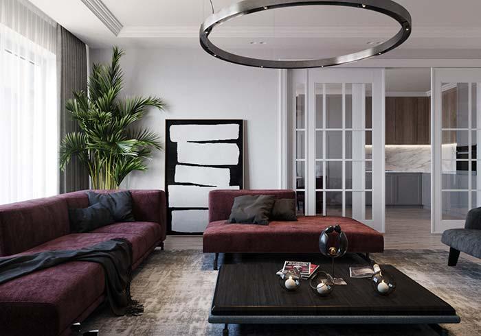 Quadro grande para sala apoiado na parede traz uma leve dose de descontração