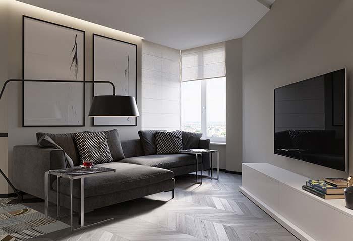 Par de quadros grandes minimalistas valorizando a decoração neutra da sala