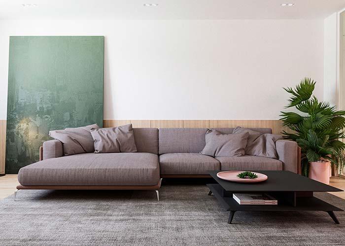 Para fazer companhia ao sofá rosé, um quadro grande para sala com sua cor complementar, o verde, trazendo contraste e realce para o ambiente