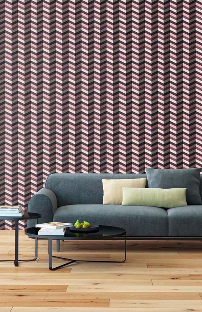 Listras em três cores diferentes formam esse papel de parede 3D com forte efeito ótico