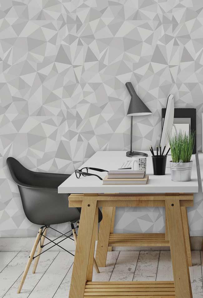 Formas geométricas em tons de cinza conferem profundidade e volume para a parede do escritório