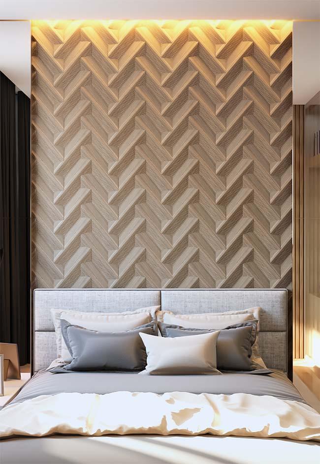 Um bom lugar para usar papel de parede 3D no quarto é junto a cabeceira da cama
