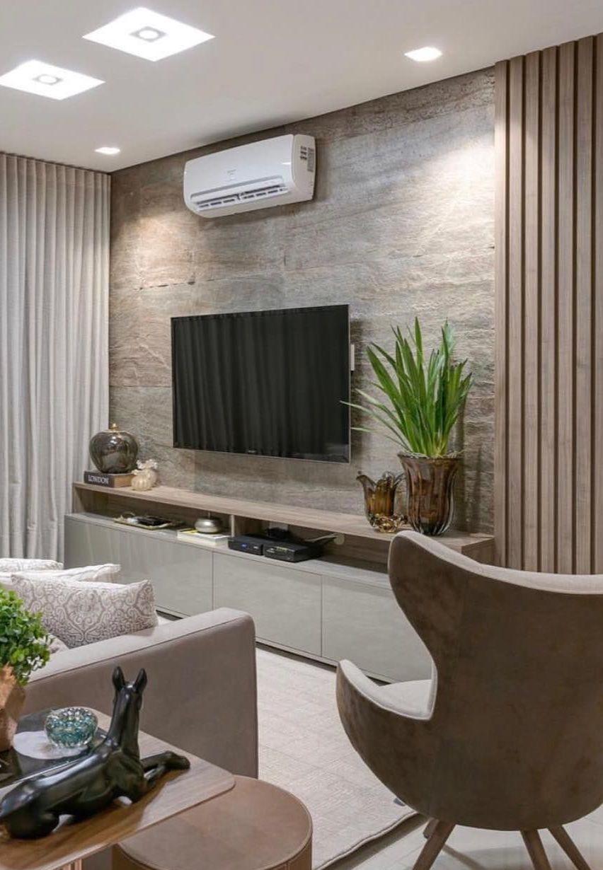 Sala de estar foi valorizada pela parede de Miracema rosa