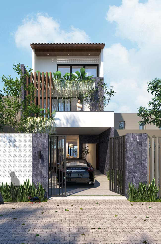 Um mix de materiais forma a fachada dessa casa, entre eles a Miracema cinza na parede