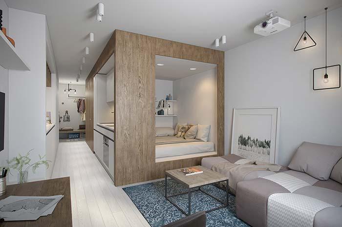 Móveis planejados: para diferenciar a área do quarto do restante dos ambientes, a solução foi emoldurá-lo em uma caixa de madeira