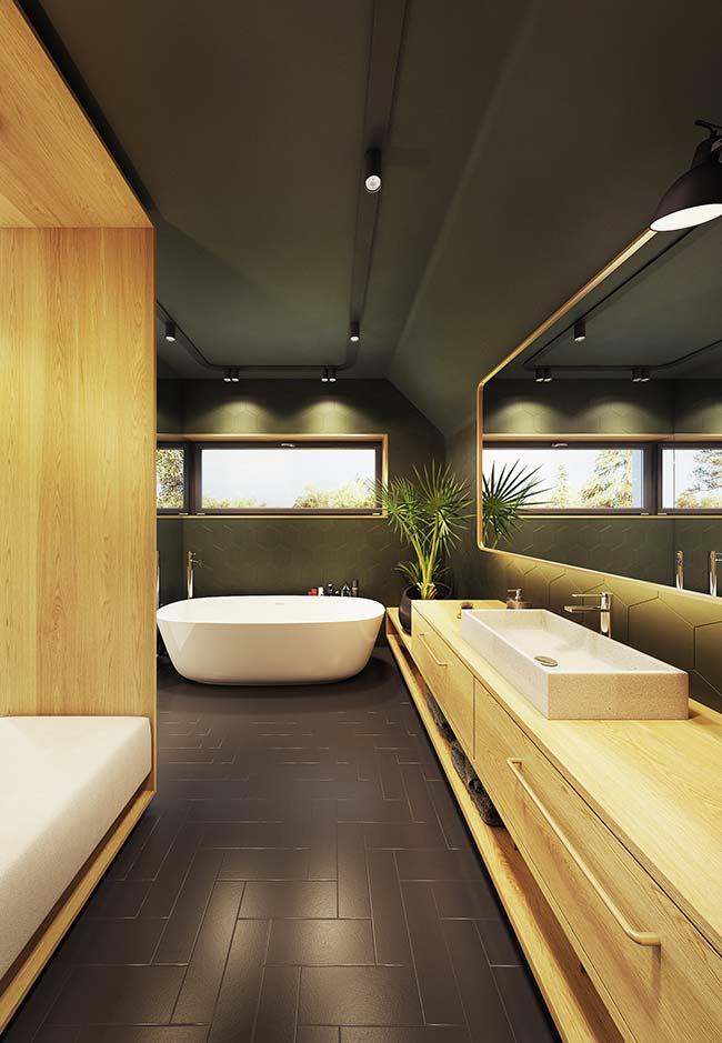 Para trazer o clima natural e o conceito de natureza para o ambiente aposte no uso da cor verde nas paredes com móveis amadeirados