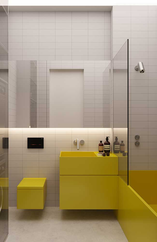 A luz branca da fita de LED traz ainda mais claridade para esse banheiro