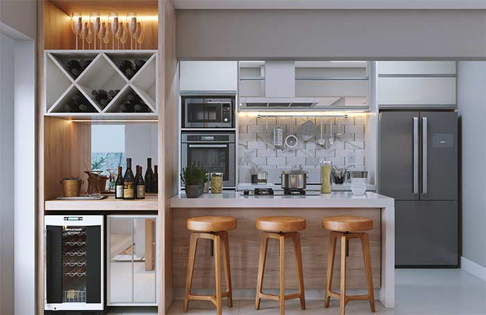 Entre a sala de estar e a cozinha, os nichos revelam todo seu potencial criativo