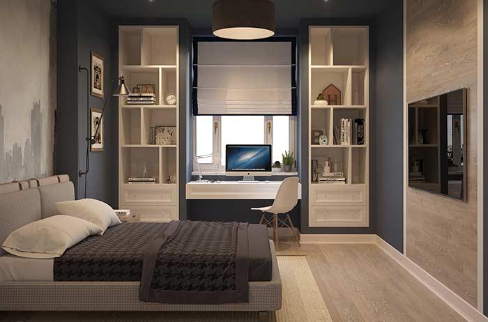 Nesse quarto, o azul petróleo forma uma moldura em torno dos nichos brancos
