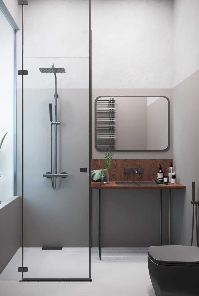 Banheiro moderno e minimalista ganhou um tom verde discreto com a Costela de Adão
