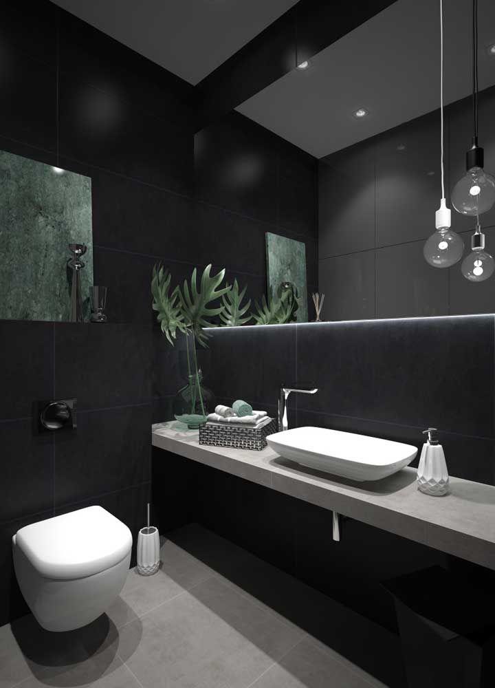 Banheiro preto decorado com folhas de Costela de Adão