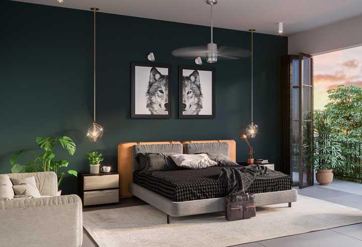 Contraste de verdes nessa sala: o da parede e o do vaso de Costela de Adão