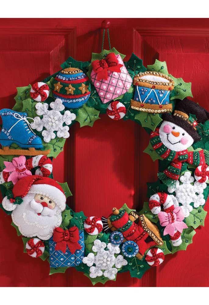 E olha que guirlanda encantadora de Natal! Toda feita em feltro