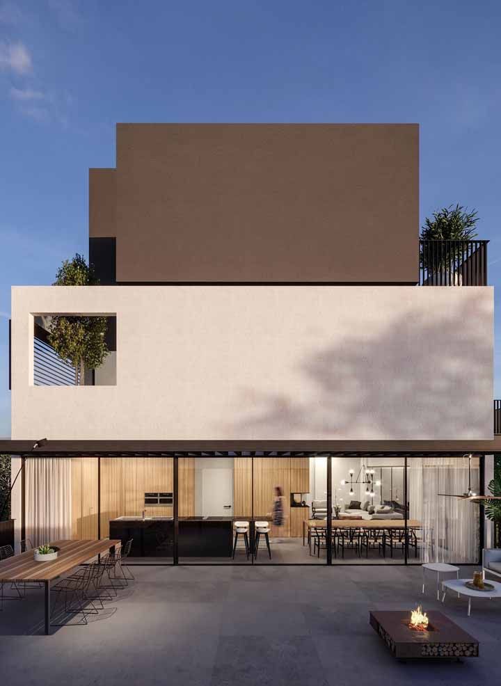 Use dois tons da mesma paleta – um mais claro e outro mais escuro - para pintar a fachada da casa