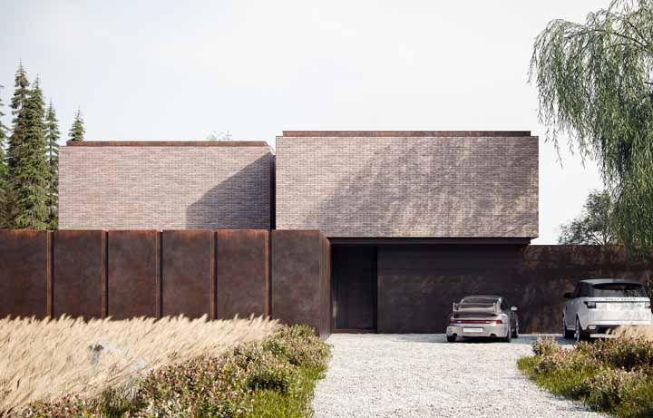 Fachada de casa feita com aço corten e tijolinho aparente: uma dupla rústica e cheia de personalidade
