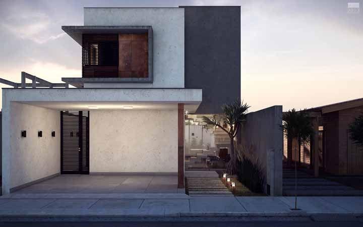 A fachada de concreto aparente ganhou um pequeno detalhe em aço corten para se diferenciar na cor e na textura