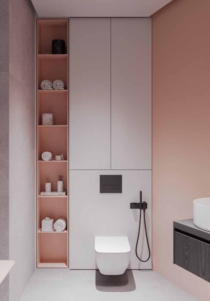 Esse banheiro é puro charme e delicadeza com a combinação entre o rosa pêssego e o branco