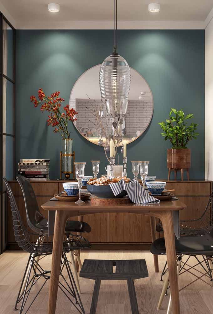 O verde e o marrom como uma referência a natureza nesta decoração de sala de jantar